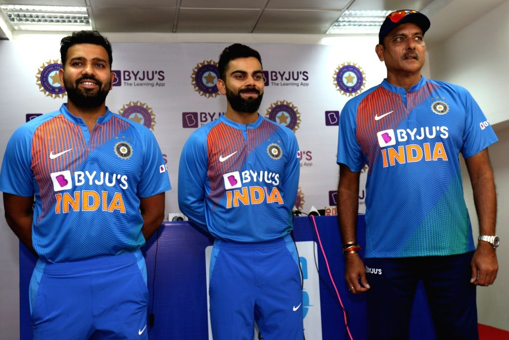 Dharamsala: Indian Head coach Ravi Shastri and cricketers Rohit Sharma and Virat Kohli showcase the team's new jersey at a press conference on the eve of their first T20I match against South Africa, at Himachal Pradesh Cricket Association Stadium in  - Rohit Sharma, Virat Kohli and Surjeet Yadav