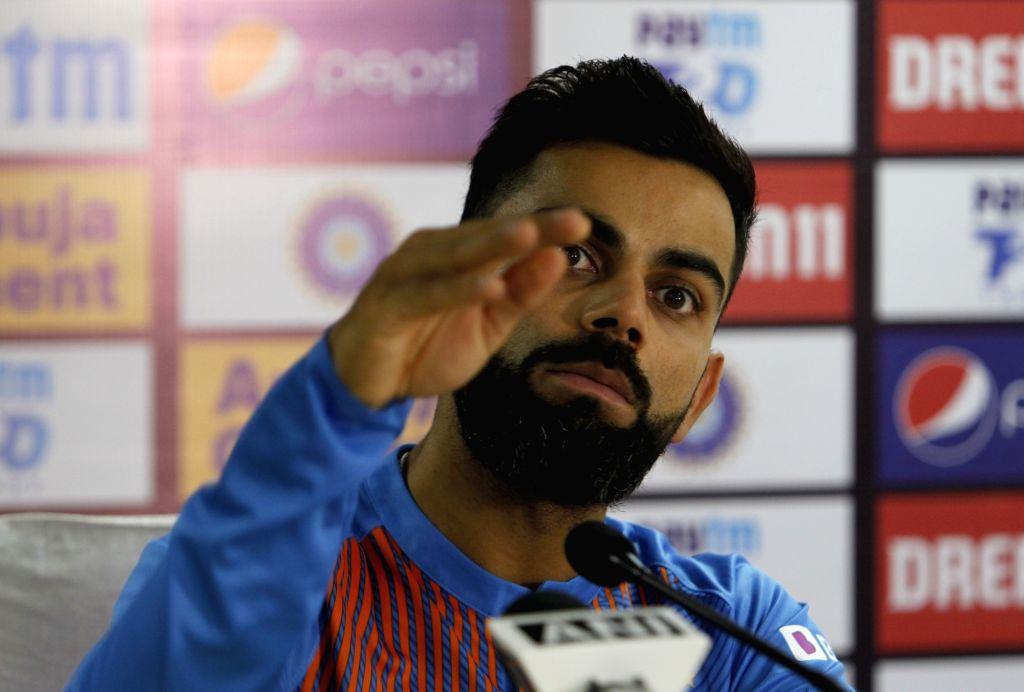 Dharamsala: Indian skipper Virat Kohli addresses a press conference on the eve of their first T20I match against South Africa, at Himachal Pradesh Cricket Association Stadium in Dharamsala on Sep 14, 2019. (Photo: Surjeet Yadav/IANS) - Virat Kohli and Surjeet Yadav