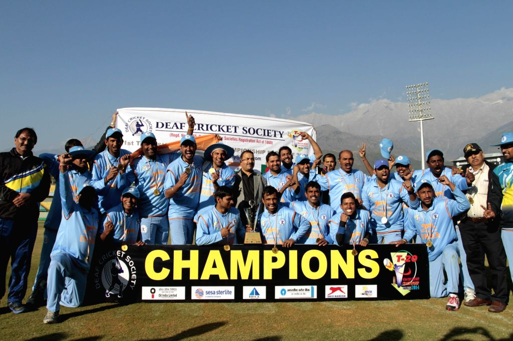 Players of Indian team pose for a photograph after winning the Asia Cup Championship for Deaf, 2014 (cricket) in Dharamsala, on Nov 23, 2014.