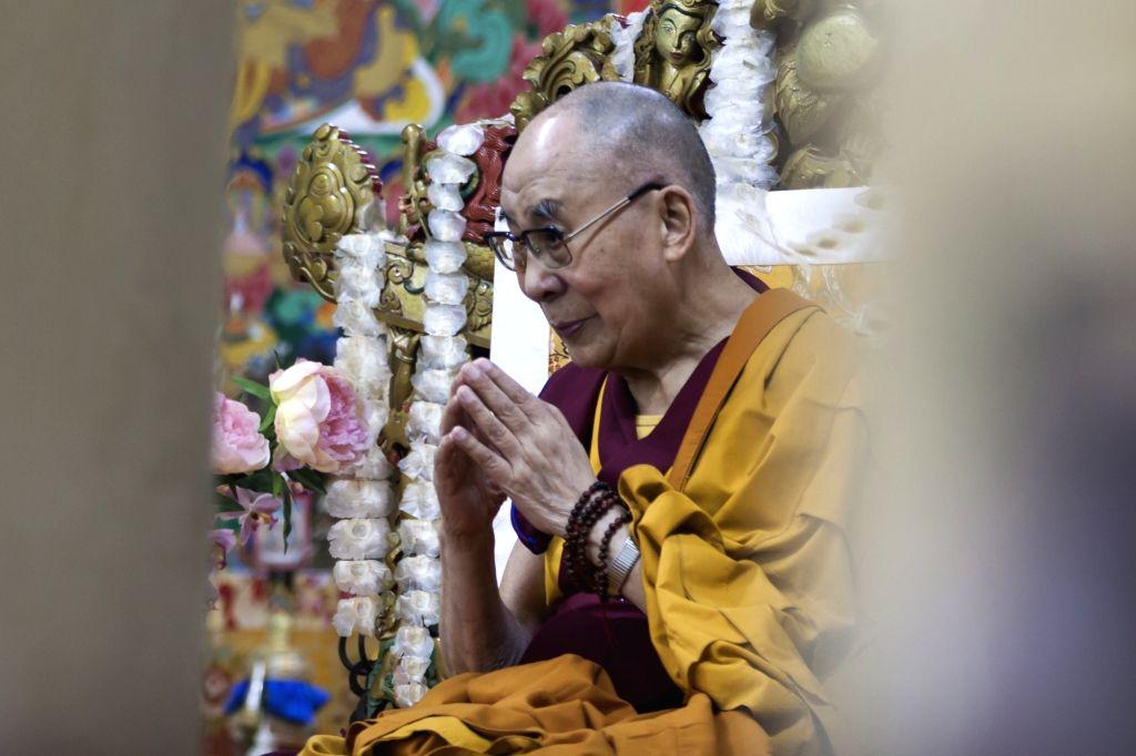 Dharamsala: Tibetan spiritual leader the Dalai Lama offers prayers at the Tsugla Khang Temple in McLeod Ganj of Himachal Pradesh's Dharamshala on July 5, 2019. (Photo: IANS)