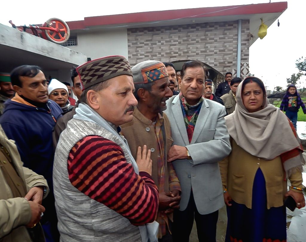 Dharamshala: Himachal Minister Kishan Kapoor consoles bereaved father of Tilak Raj, who was among the 45 CRPF personnel killed in a suicide attack by militants in Jammu and Kashmir's Pulwama district on 14th Feb 2019; in Dharamsala on Feb 15, 2019. ( - Kishan Kapoor