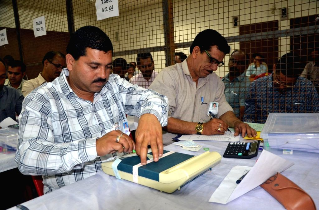 Dharamshala: Polling officials busy counting votes cast during the recently concluded 2019 Lok Sabha polls at a counting centre in Dharamshala, on May 23, 2019. (Photo: IANS)