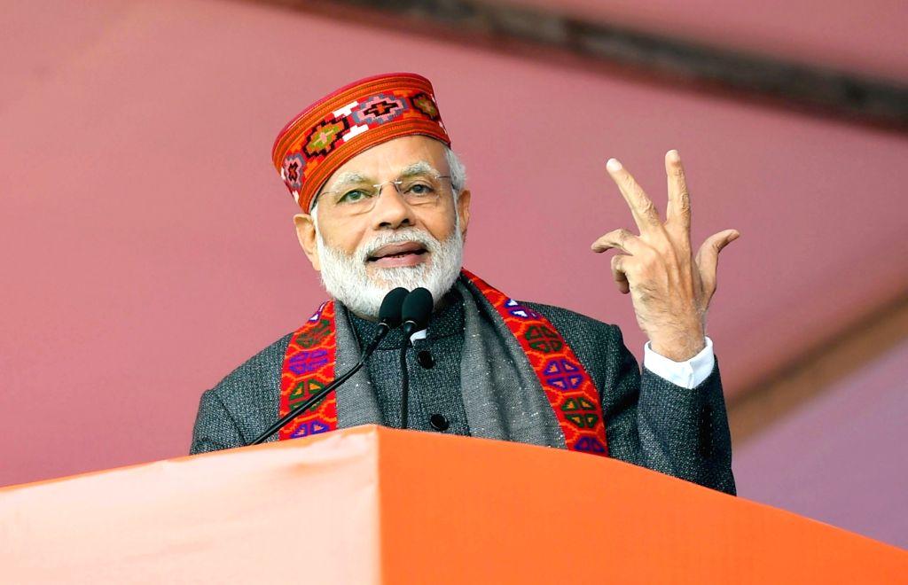 Dharamshala: Prime Minister Narendra Modi addresses during a public meeting in Dharamshala, Himachal Pradesh on Dec 27, 2018. (Photo: IANS/PIB) - Narendra Modi