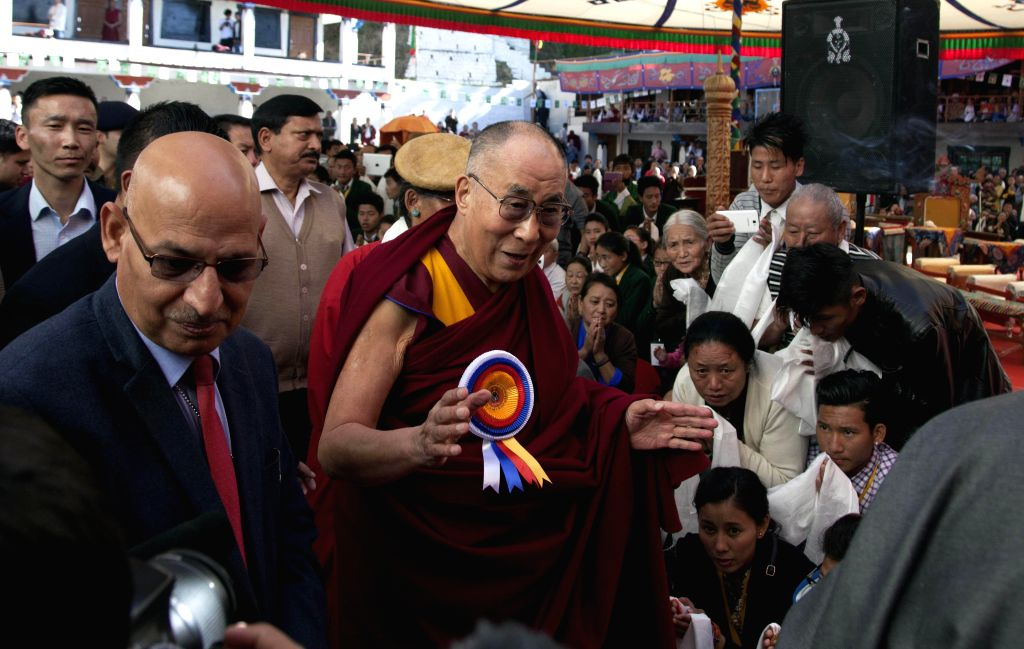 Dalai Lama the spiritual head of Tibetan Buddhists blesses his followers on his arrival at the Tibetan Institute of Performing Arts in Dharmsala, on March 27, 2015.