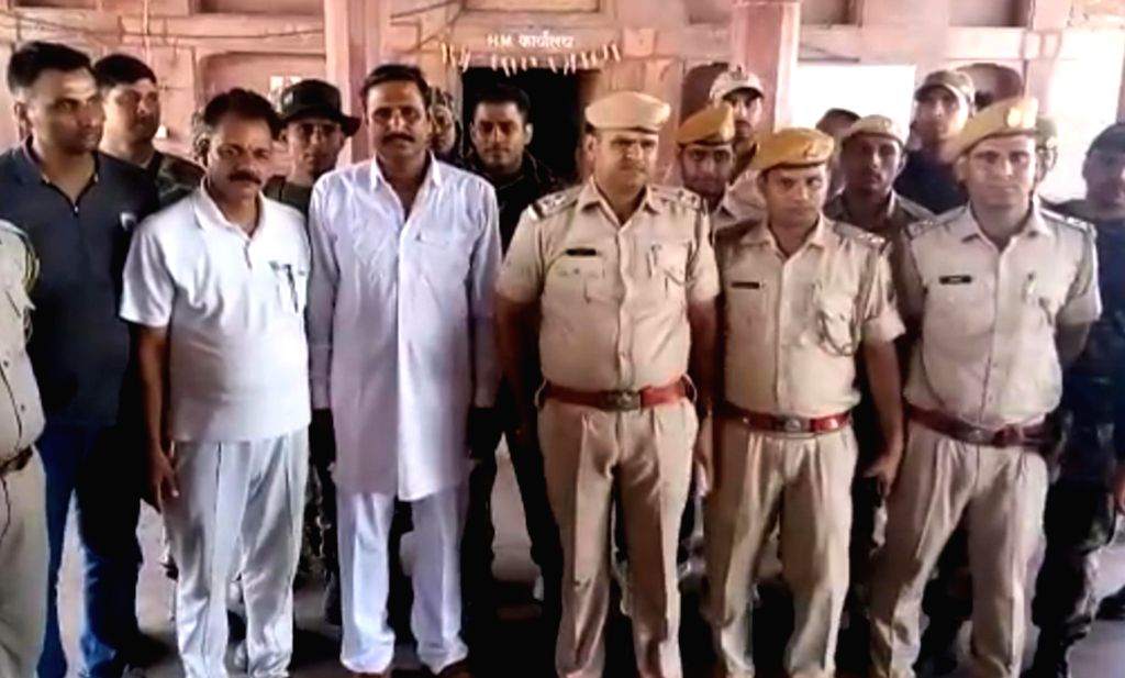 Dholpur: Jagan Gujjar, who had 100 cases registered against him in Uttar Pradesh, Rajasthan and Madhya Pradesh including looting, dacoity and attempt to murder, surrenders before police in Dholpur on June 28, 2019. (Photo: IANS)