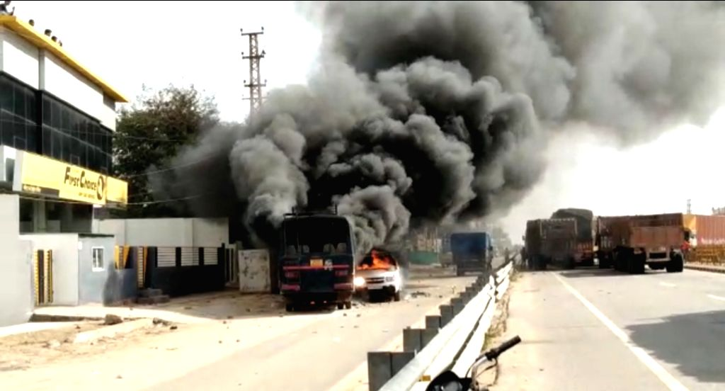 Dholpur: Vehicles set ablaze by an irate mob after Gujjar stir turned violent in Dholpur of Rajasthan on Feb 10, 2019. (Photo: IANS)