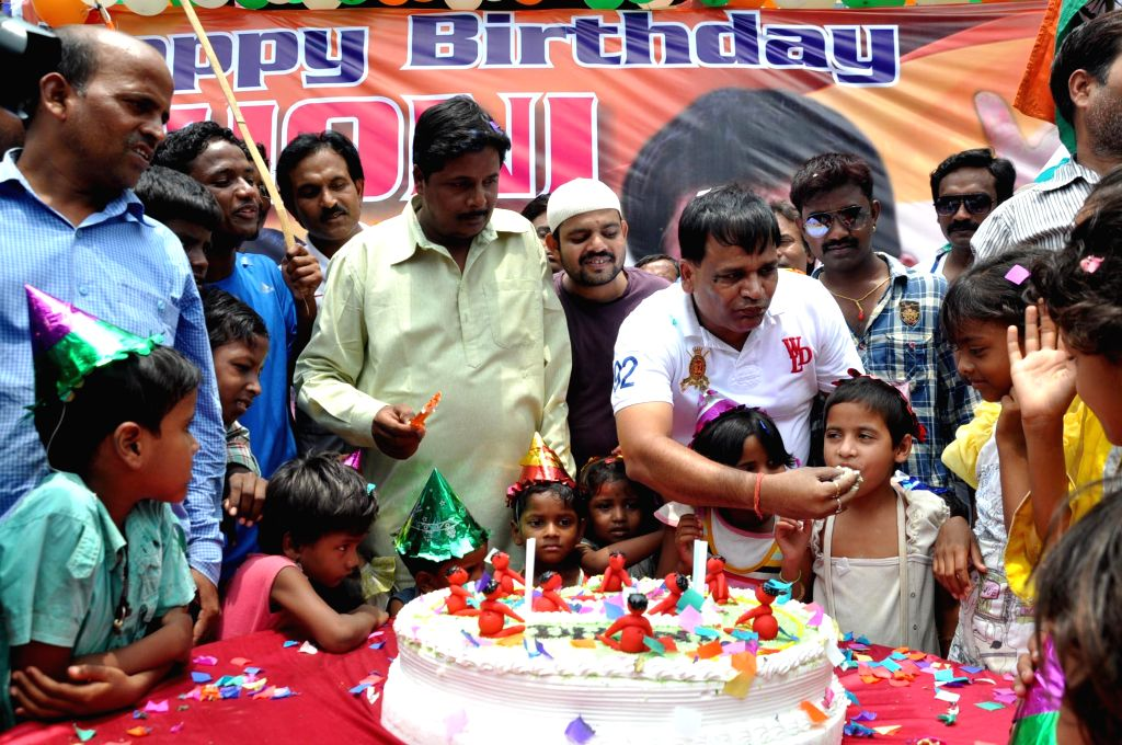 Dhoni Fans' Club members celebrate the birthday of Indian cricketer MS Dhoni at Albert Ekka Chowk in Ranchi on July 7, 2014.