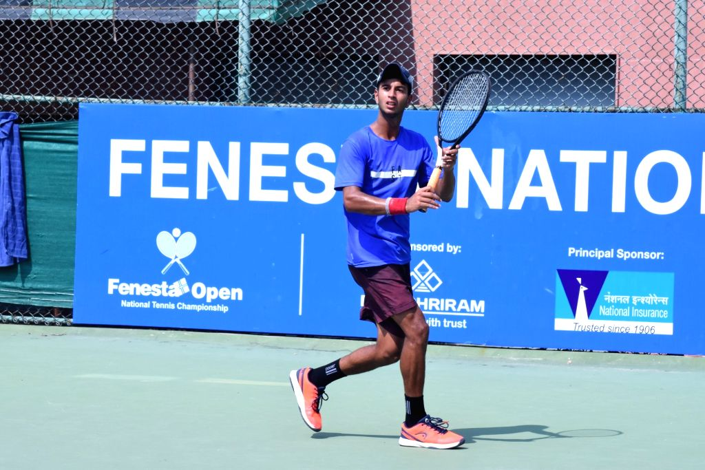 Dhruv Tangri in action against Manas Dhamne in Boys U-16 category of the Fenesta Open Junior National Tennis Championship, in New Delhi on Oct 9, 2019.