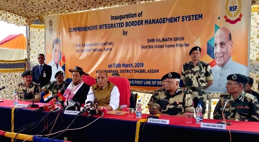 Dhubri: Union Home Minister Rajnath Singh along with Assam Chief Minister Sarbananda Sonowal and BSF Director General Rajni Kant Mishra addresses a press conference on the sidelines of the inauguration of Comprehensive Integrated Border Management Sy - Rajnath Singh and Rajni Kant Mishra