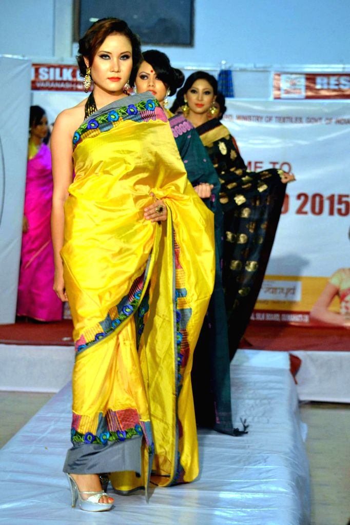 Models walk the ramp during a fashion show in Dibrugarh of Assam on March 14, 2015.