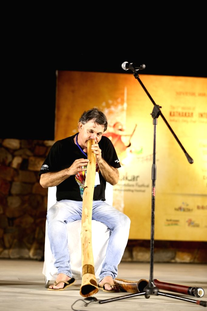 Didgeridoo musician Ron Murray playing the long, uneven wooden instrument as a tradition of welcome
