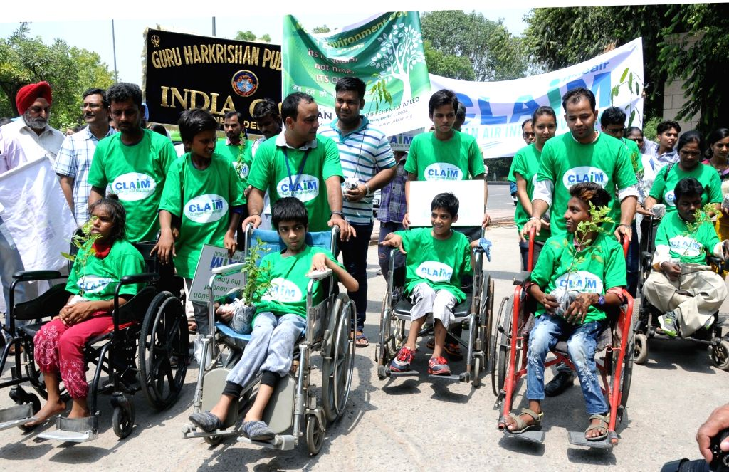 Differently able children participate in an awareness rally on World Environment Day near India Gate in New Delhi, on June 5, 2016.