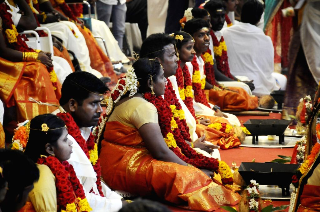 Differently-abled couples participate in a mass wedding jointly organised by Shree Geeta Bhavan Trust and Tamil Nadu Differently Abled Federation Charitable Trust, where 48 couples got ...