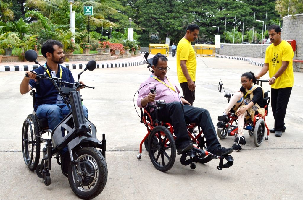 Differently-abled people being taught to use assistive gadgets at National Conference on Assistive Technology for All by 2030 organised by Mobility India, in Bengaluru on Aug 2, 2019.