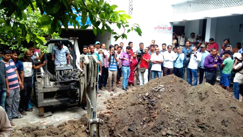 Digging work commences in the premises of Seva Sankalp Evam Vikas Samiti, a state-run shelter home on Sahu Road in Muzaffarpur to exhume the body of girl who was suspected to be buried ...