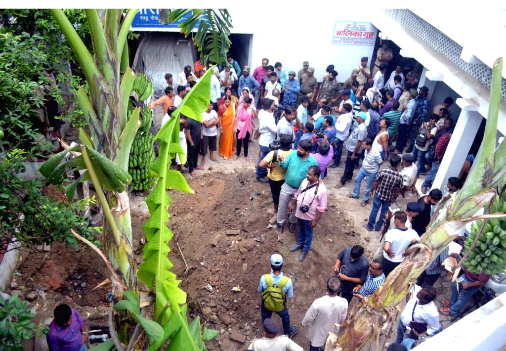 Digging work underway in the premises of Seva Sankalp Evam Vikas Samiti, a state-run shelter home on Sahu Road in Muzaffarpur to exhume the body of girl who was suspected to be buried ...