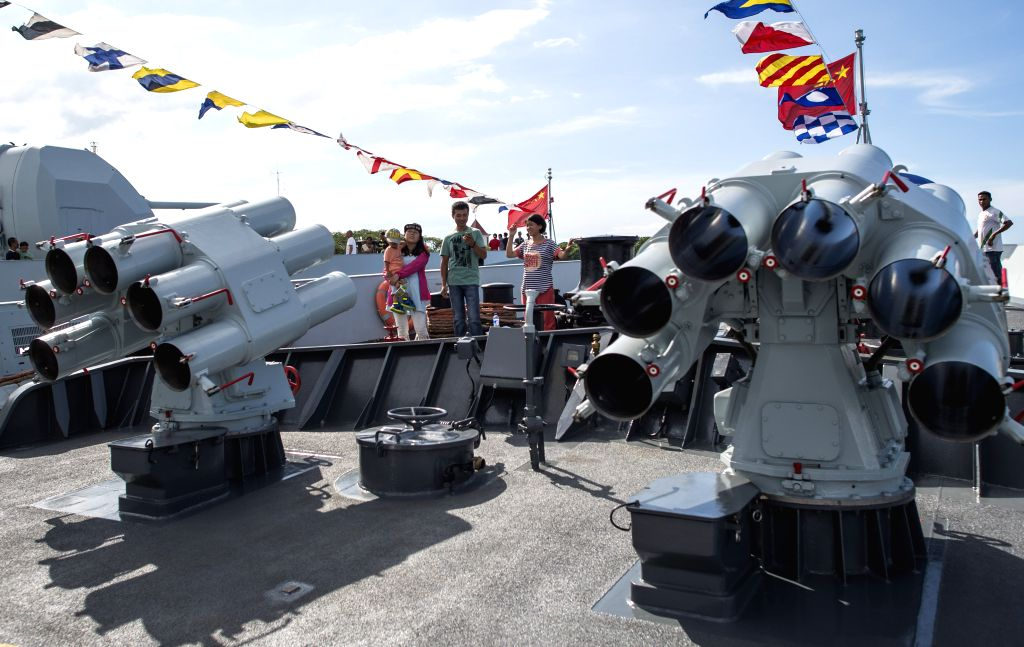 DILI, TIMOR-People visit a Chinese Navy warship at Dili, Democratic Republic of Timor-Leste, Jan. 17, 2015. A Chinese Navy task force on Saturday arrived in Dili to ...