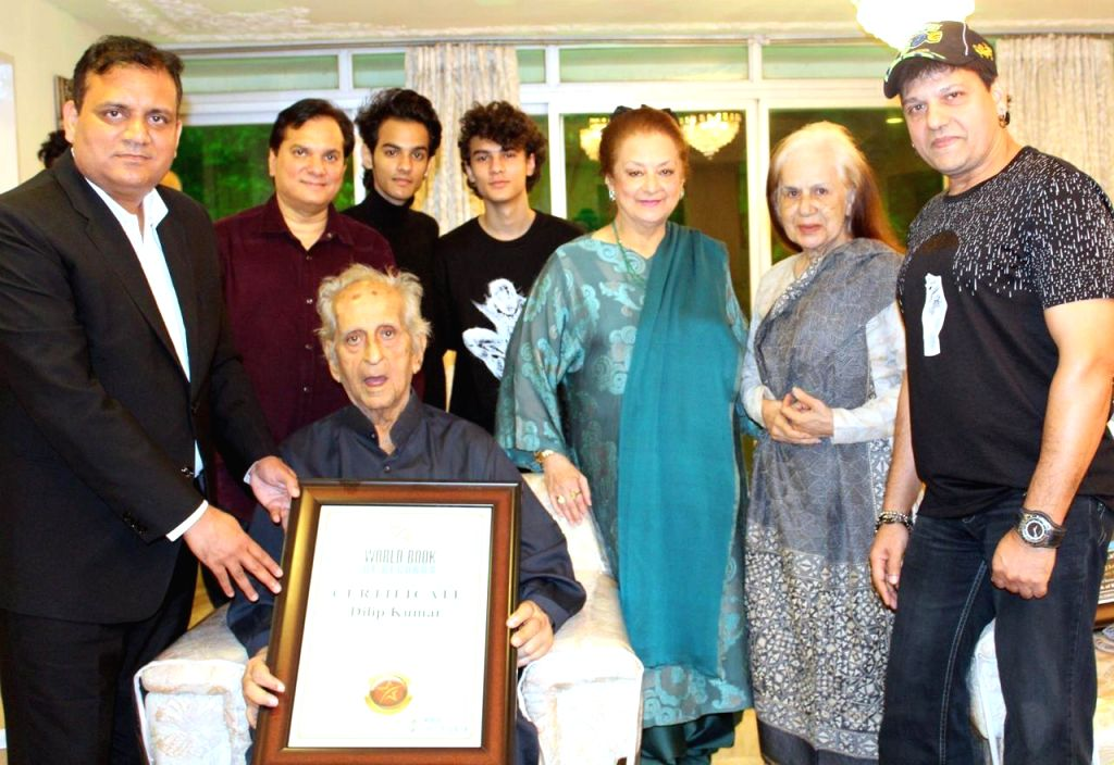 Dilip Kumar was felicitated by World Book of Records, London on his 97th birthday. His brother Aslam Khan collected the Certificate of Honour on his behalf. - Dilip Kumar and Aslam Khan
