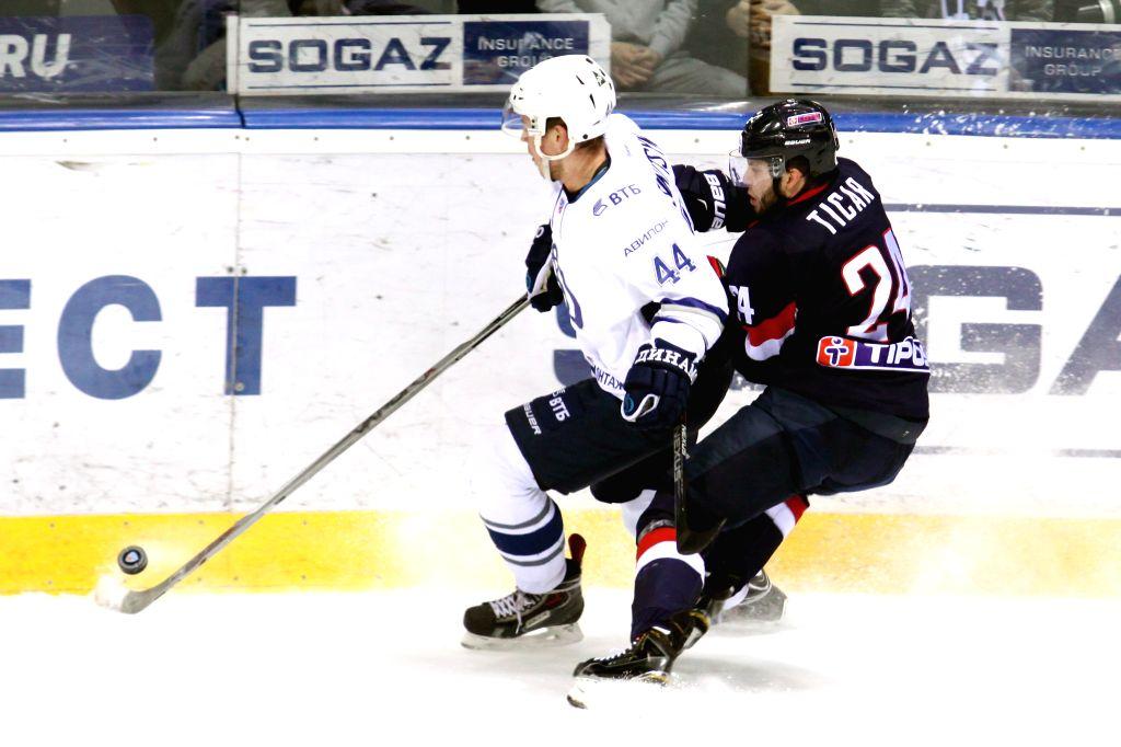Dimitry Sinitsyn (L) of Dynamo Moscow vies with Rok Ticar of HC Slovan Bratislava during a Kontinental Hockey League (KHL) match in Bratislava, Slovakia, on Jan. ...
