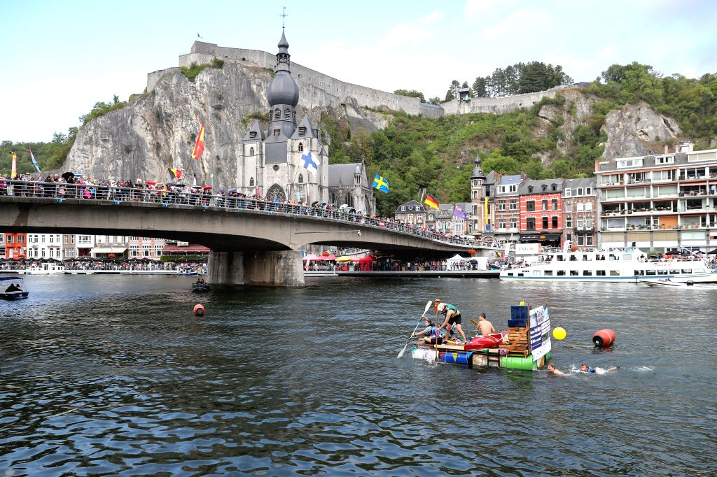 DINANT (BELGIUM), Aug. 15, 2019 Participants attend the International Bathtub Regatta on the Meuse River in Dinant, Belgium, on Aug. 15, 2019. Starting in 1982, participants vie to create ...
