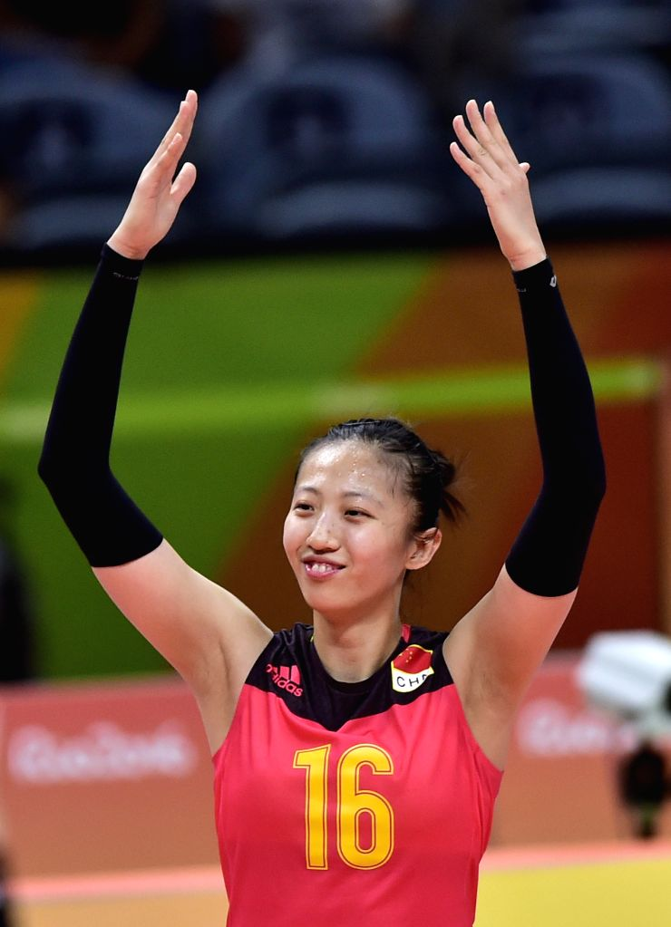 ?Ding Xia of China celebrates scoring during the women's volleyball heat between China and Italy at the 2016 Rio Olympic Games in Rio de Janeiro, Brazil, on ...
