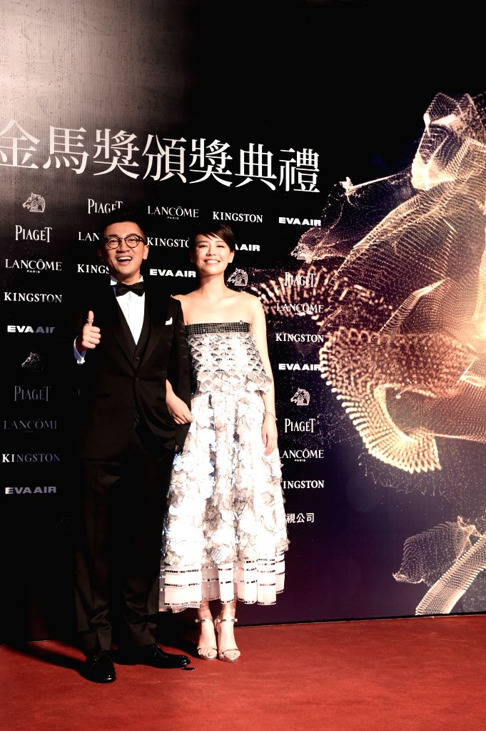 """Director Alec Su and actress Sandra of movie """"The Left Ear"""" arrive for the 52nd Golden Horse Awards in Taipei, southeast China's Taiwan, Nov. 21, 2015. The ... - Sandra"""