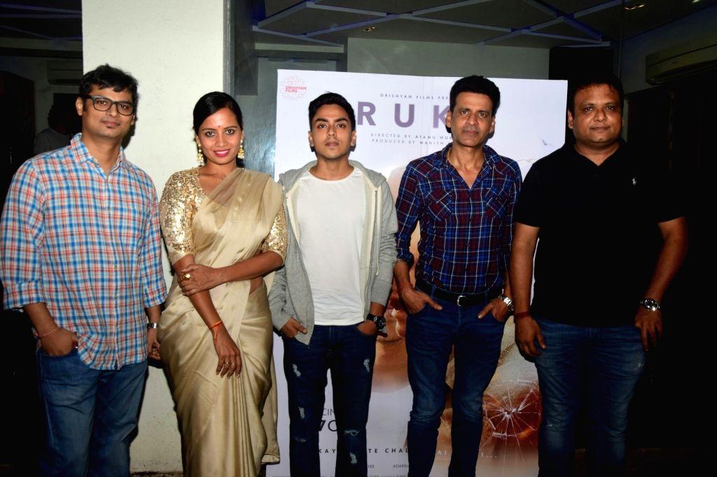 "Director Atanu Mukherjee and actors - Manoj Bajpayee, Smita Tambe, Adarsh Gourav during the screening of their upcoming film ""Rukh"" in Mumbai on Oct 21, 2017. - Atanu Mukherjee and Manoj Bajpayee"