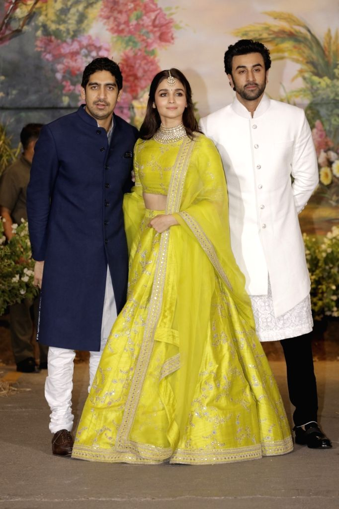 Director Ayan Mukerji, actors Ranbir Kapoor and Alia Bhatt at the wedding reception of actress Sonam Kapoor and businessman Anand Ahuja in Mumbai on May 8, 2018. - Sonam Kapoor, Ranbir Kapoor and Alia Bhatt