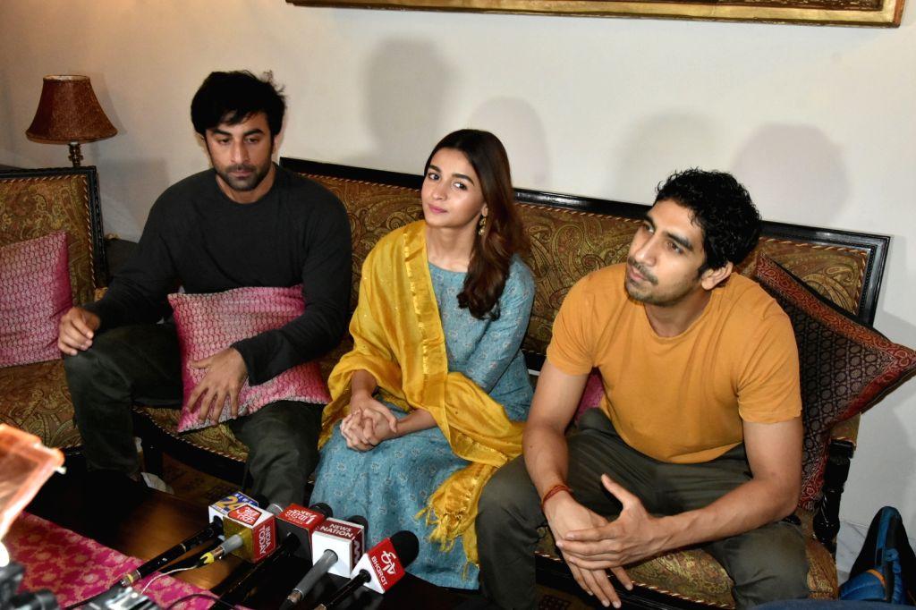 "Director Ayan Mukerji with actors Ranbir Kapoor and Alia Bhatt at a press conference regrading their upcoming film ""Brahmastra"" in Varanasi on June 12, 2019. - Ranbir Kapoor and Alia Bhatt"