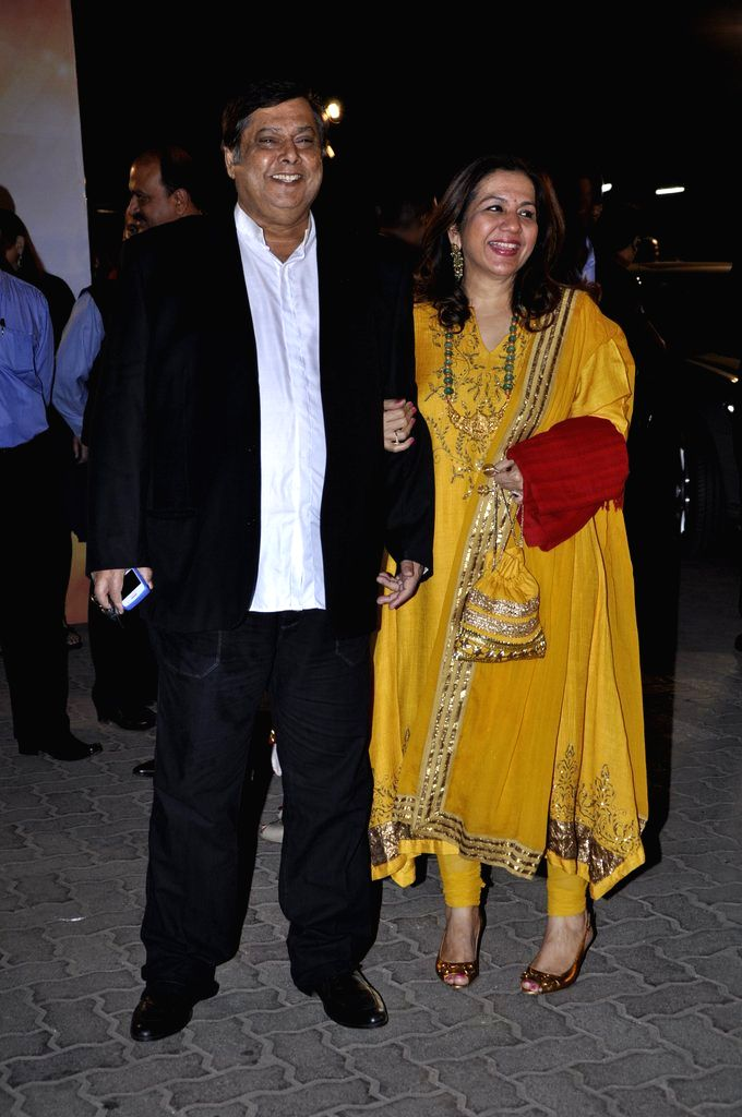 Director David Dhawan arrives at the red carpet of The Filmfare Awards 2013 in Mumbai.
