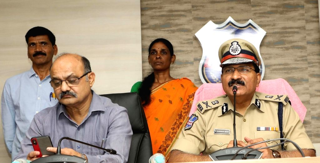 Director General of Police (DGP) M Mahender Reddy addresses a press conference after top Maoist leader Buriyar Sathwaji and his wife Vydugula Aruna, also a Maoist, surrendered before ... - M Mahender Reddy