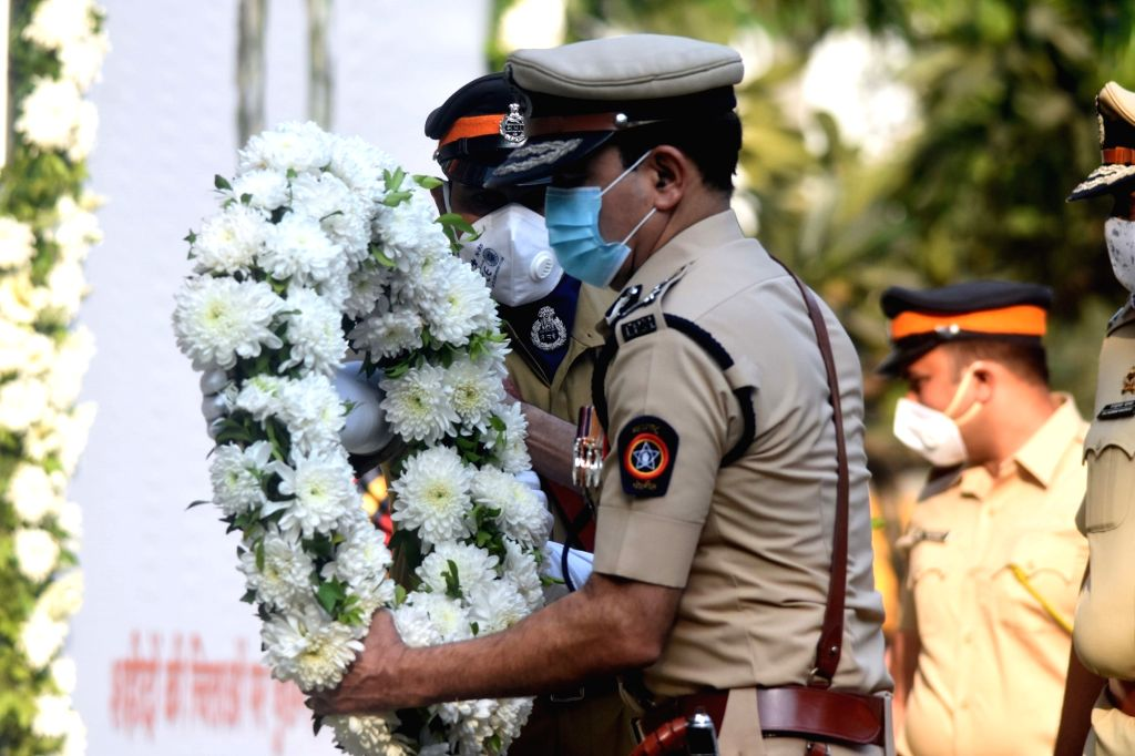 Director-General of Police Subodh Jaiswal pays tributes to the martyrs and victims felled by bullets and brave-hearts who helped save and secure the city from the assault by 10 Pakistani ...