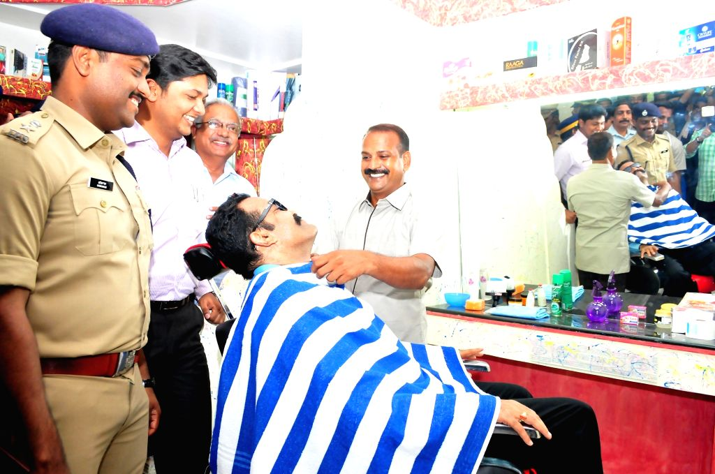 Director General of Prisons Rishiraj Singh gets a haircut at the newly inaugurated men's salon run by inmates of the Central Prison in Kannur of Kerala on April 20, 2016. - Rishiraj Singh