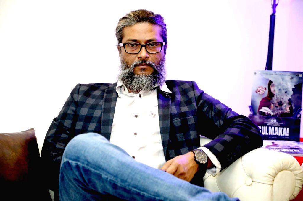 Director H.E. Amjad Khan. - E. Amjad Khan