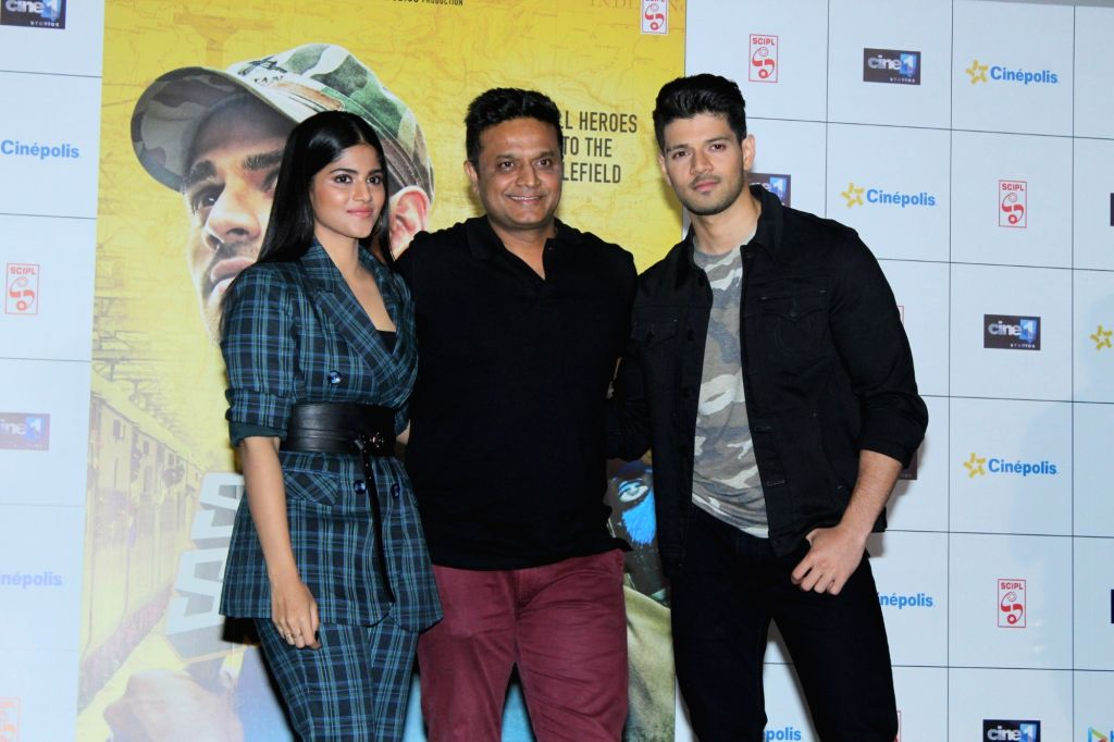 "Director Irfan Kamal with actors Sooraj Pancholi and Megha Akash during the trailer launch of their upcoming film ""Satellite Shankar"" in Mumbai on Oct 17, 2019. - Sooraj Pancholi and Megha Akash"