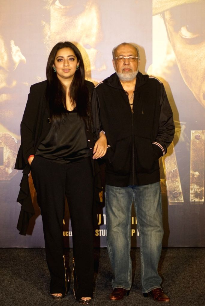 """Director J.P. Dutta with his daughter Nidhi Dutta at the trailer launch of his upcoming film """"Paltan"""", in Mumbai on Aug 2, 2018."""