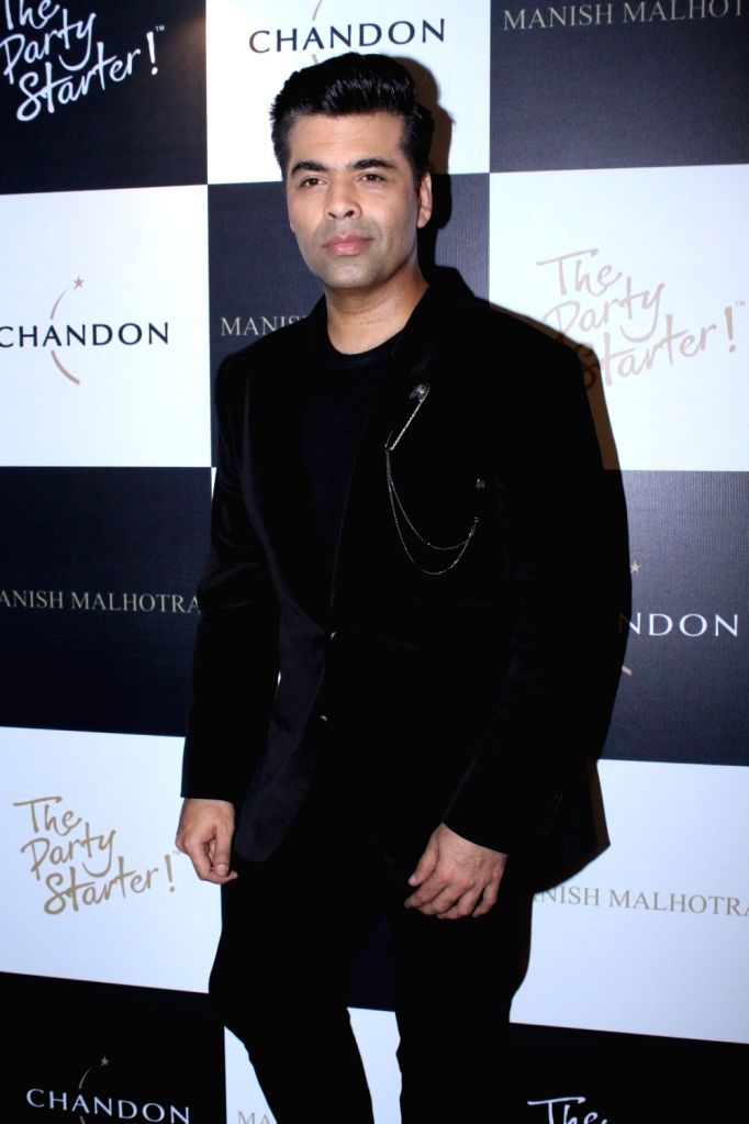 Director Karan Johar during the launch of Manish Malhotra X Chandon Champagne bottles Limited Edition End Of Year 2017 in Mumbai on Oct 9, 2017. - Karan Johar