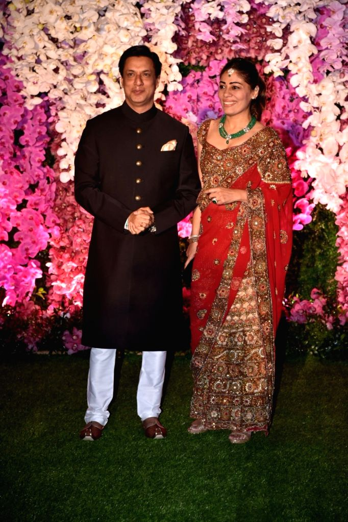Director Madhur Bhandarkar along with his wife Renu Namboodiri at the wedding reception of Akash Ambani and Shloka Mehta in Mumbai on March 10, 2019. - Akash Ambani and Shloka Mehta