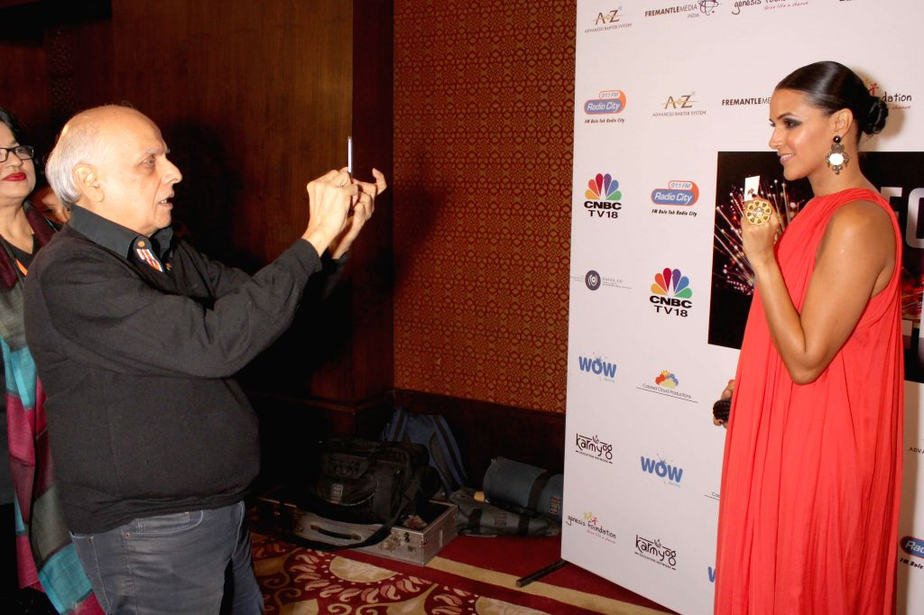 Director Mahesh Bhatt, Actress Neha Dhupia and Colors CEO Raj Nayak at the CEO's talent hunt event, in association with genesis foundation in New Delhi on Nov. 15, 2014. - Neha Dhupia