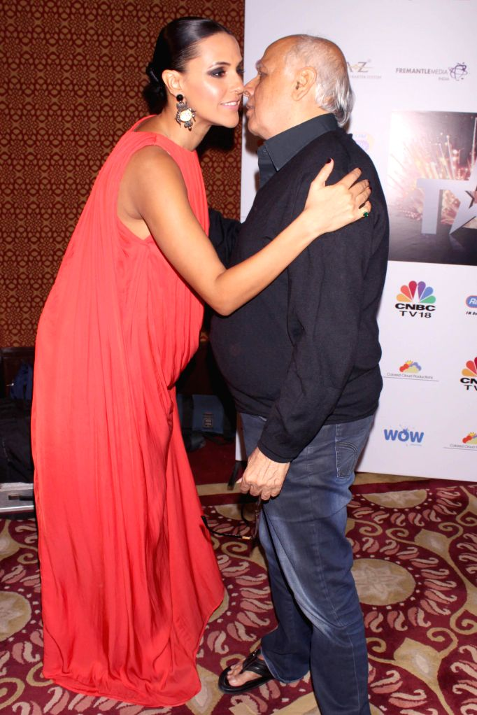 Director Mahesh Bhatt and Actress Neha Dhupia at the CEO's talent hunt event, in association with genesis foundation in New Delhi on Nov. 15, 2014. - Neha Dhupia