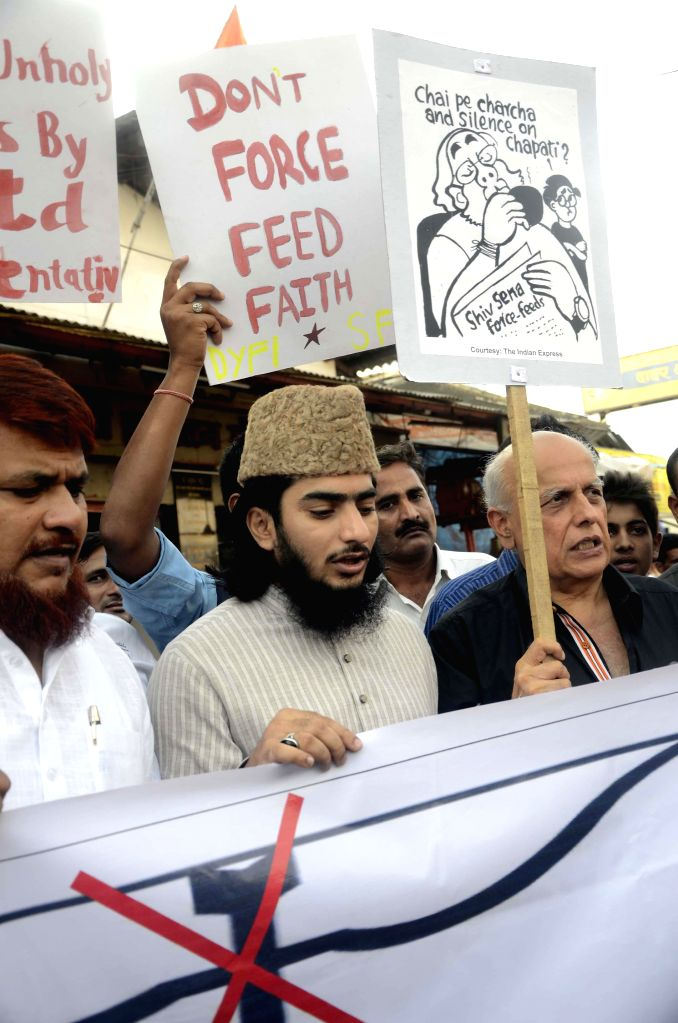 Director Mahesh Bhatt led a protest against the recent incident of Maharashtra Sadan where a Shiv Sena Member of Parliament (MP) forced a Muslim catering supervisor to break his Ramzan fast with NGO .