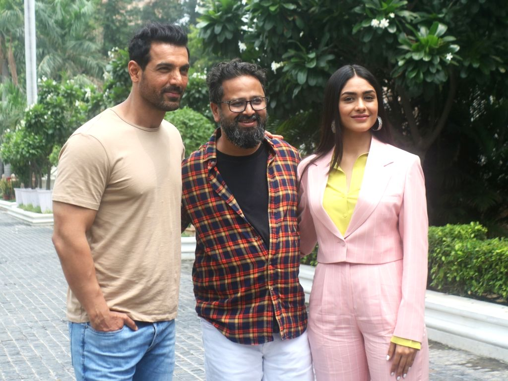 "Director Nikhil Advani with actors John Abraham and Mrunal Thakur during the promotions of their upcoming film ""Batla House"", in New Delhi on Aug 3, 2019. - John Abraham, Mrunal Thakur and Nikhil Advani"