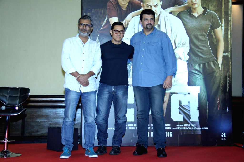 Director Nitesh Tiwari, actor Aamir Khan and producer Siddharth Roy Kapur during the poster launch of their upcoming film 'Dangal' in Mumbai on July 4, 2016. - Aamir Khan and Siddharth Roy Kapur