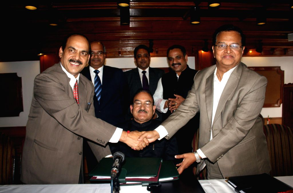 Director of National Health Mission for Himachal Pradesh, Hans Raj Sharma and Director of GVK EMRI K.Krishnam Raju sign a memorandum of understanding (MOU) for 102 ambulances in presence of state's .. - Kaul Singh Thakur and Raj Sharma