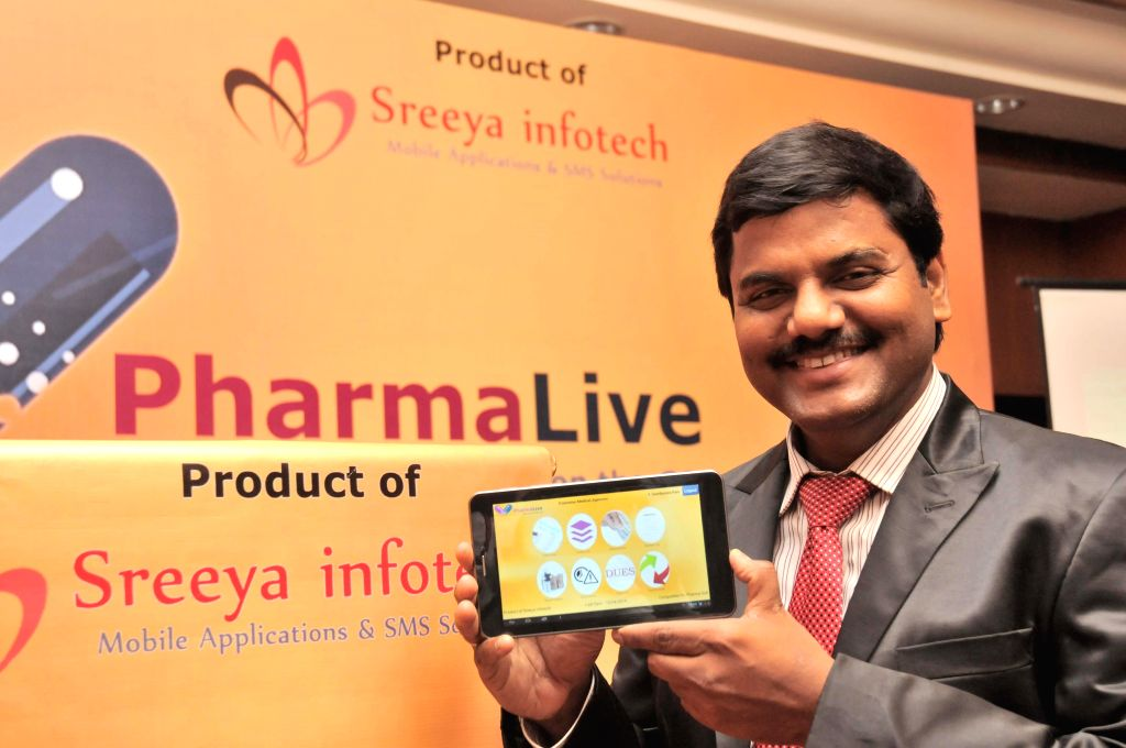 Director of Sreeya Infotech, Sridhar Narra launches a mobile application in Hyderabad on April 10, 2014.
