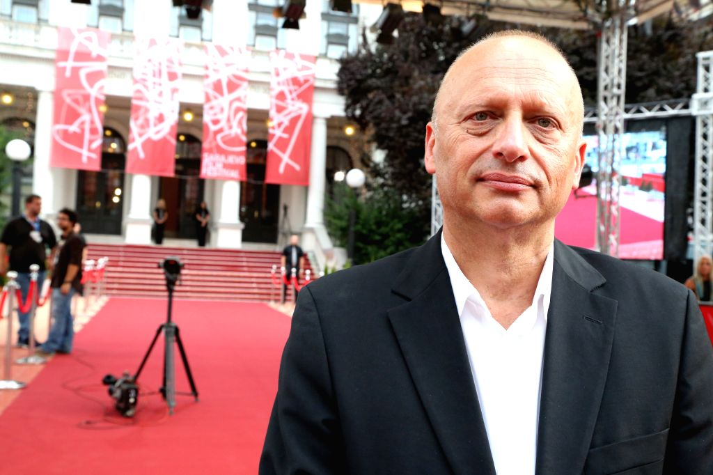 Director of the 21st Sarajevo Film Festival Mirsad Purivatra poses for photos in front of the National Theater in Sarajevo, Bosnia-Herzegovina, Aug. 14, 2015. The ...