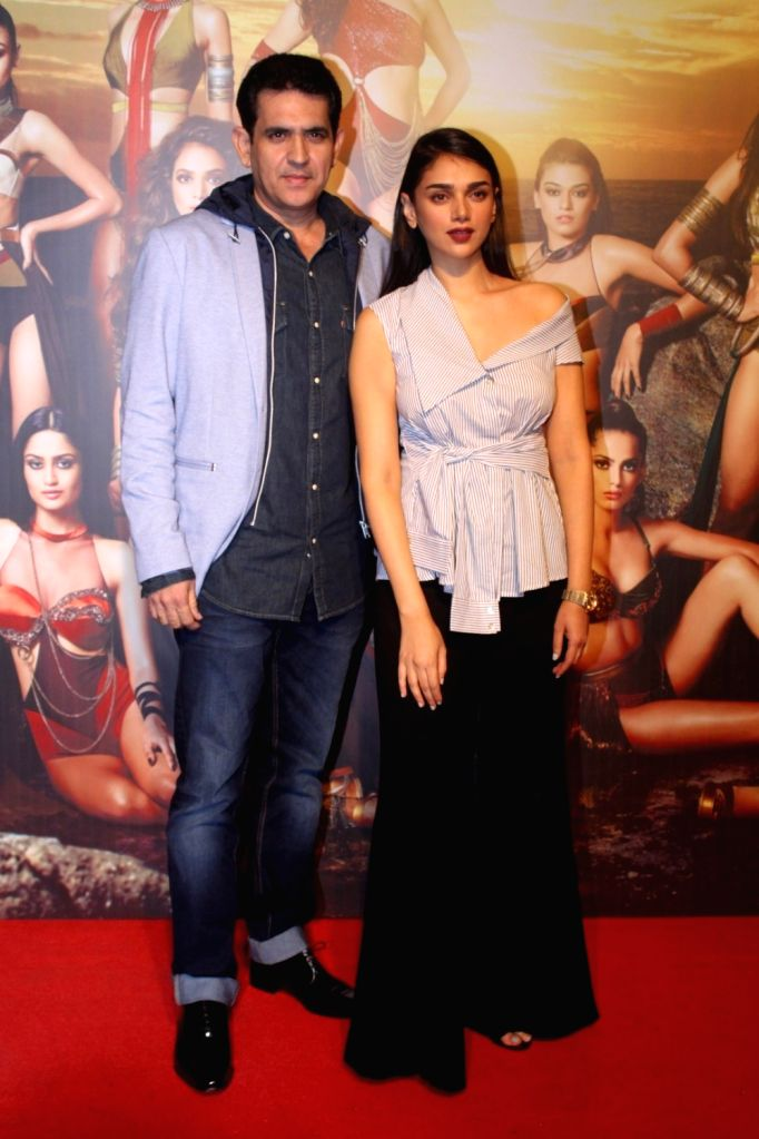 "Director Omung Kumar and Actress Aditi Rao Hydari at the star studded red carpet of ""Miss Diva 2017"" in Mumbai on Sept 18, 2017. - Aditi Rao Hydari and Omung Kumar"