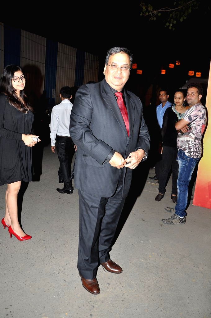 Director Subhash Ghai arrives at the red carpet of The Filmfare Awards 2013 in Mumbai.
