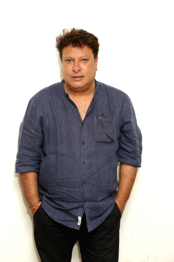 """Director Tigmanshu Dhulia during an interaction programme ahead of the release of his upcoming film """"Milan Talkies"""" at IANS office, in Noida, on March 13, 2019."""