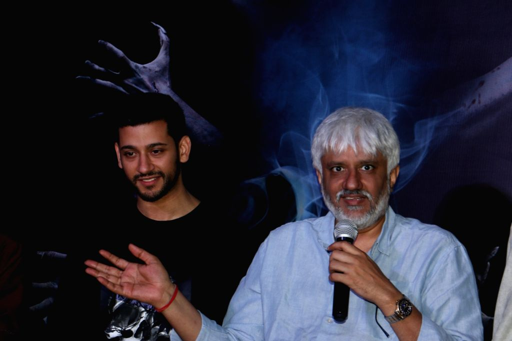 """Director Vikram Bhatt accompanied by actor Shivam Bhaargava, addresses at a press conference during the promotions of their upcoming film """"Ghost"""" in Mumbai on Oct 15, 2019. - Shivam Bhaargava"""